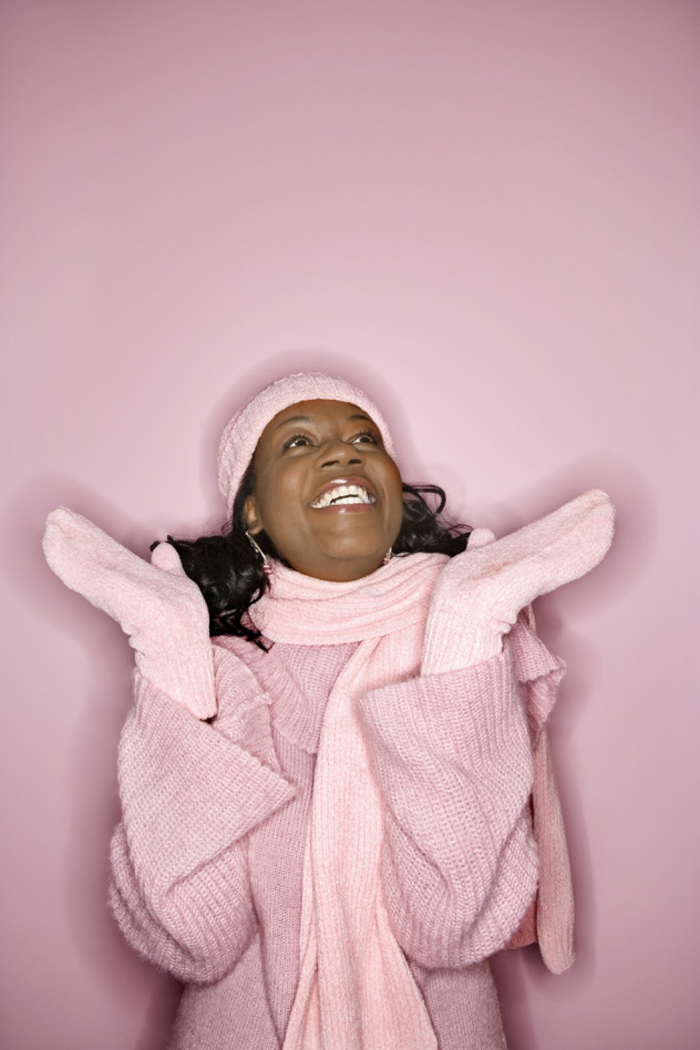 Smiling woman in winterwear.